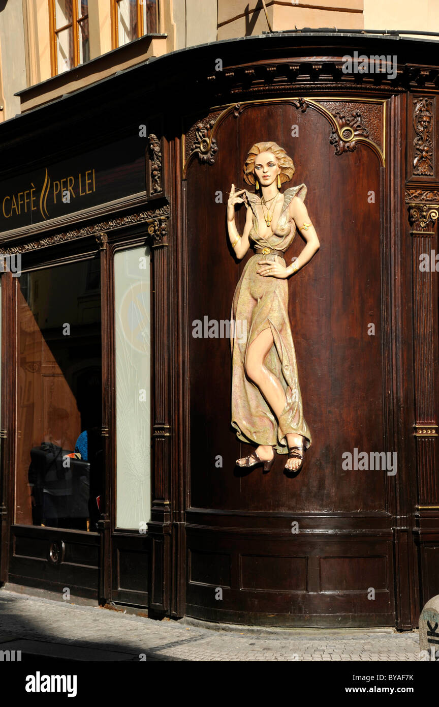 Art Nouveau house emblem of a lascivious woman, wood relief on the facade of the Caffè per Lei Cafe, historic district, Stock Photo