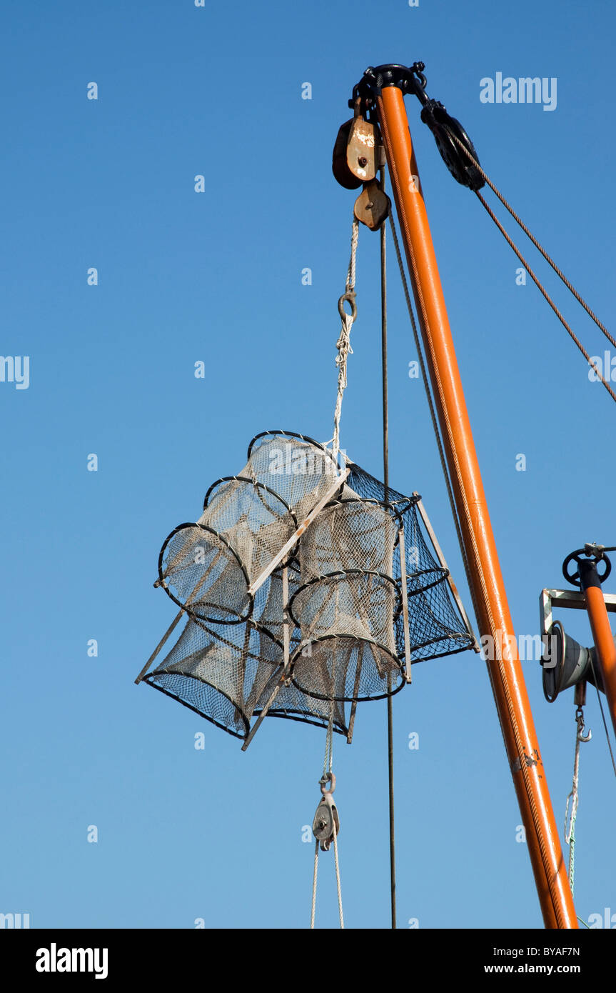 Lobster traps / creels hanging from mast, Breskens, The Netherlands Stock Photo