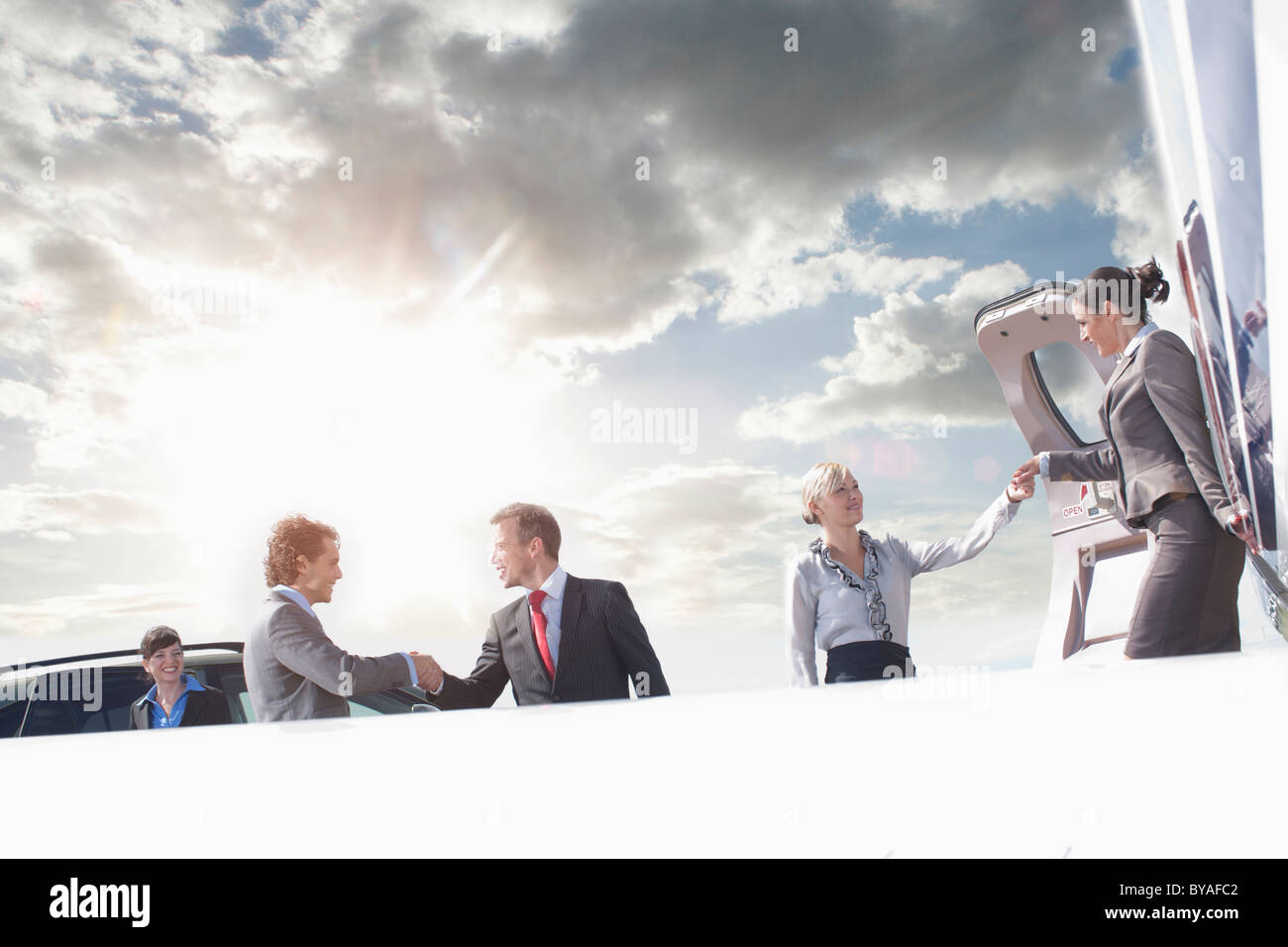 Business executives on corporate jet - Stock Image
