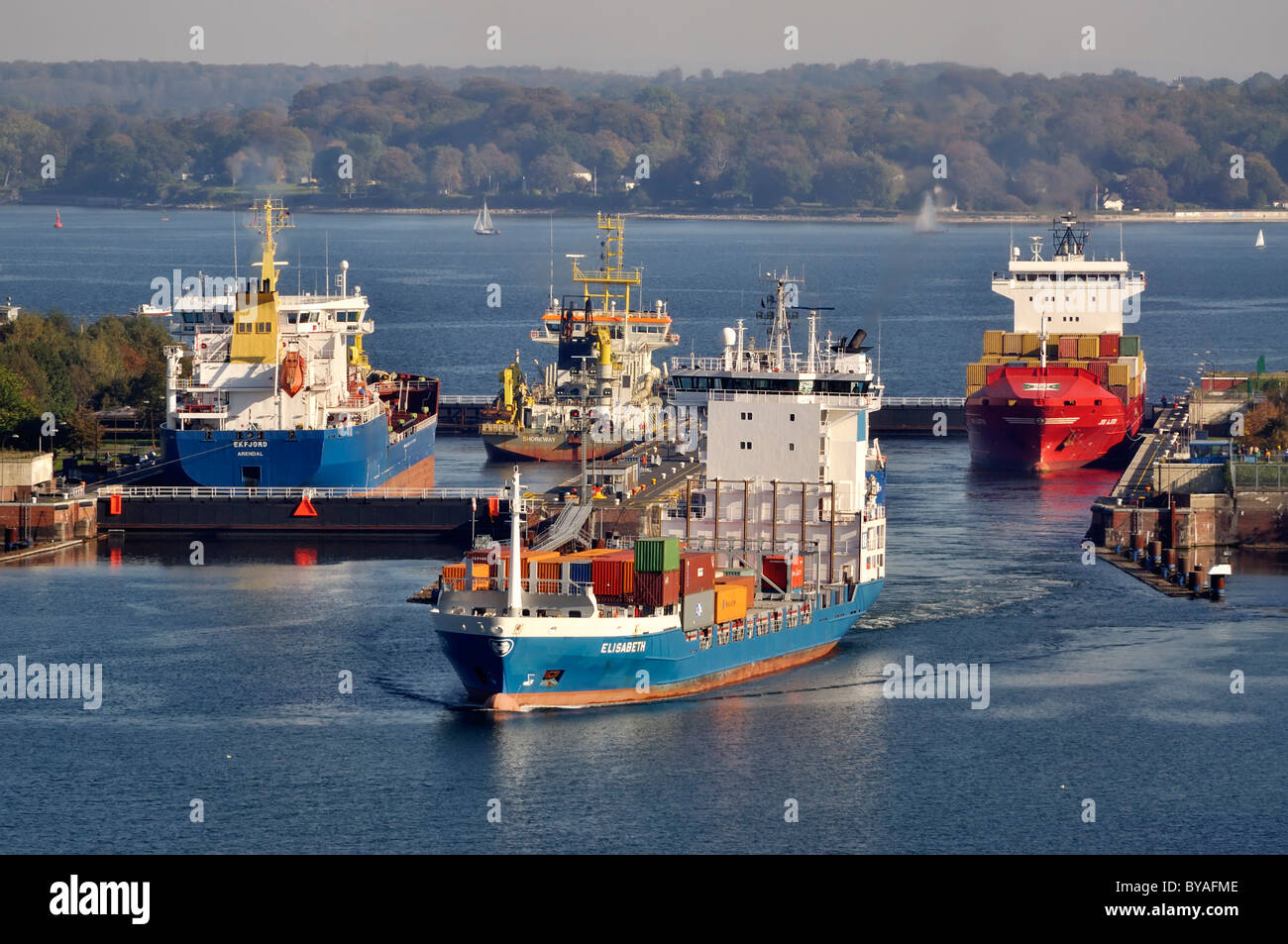 Shipping container ships at Holtenau lock, Kiel Canal, Kiel, Schleswig-Holstein, Germany, Europe - Stock Image
