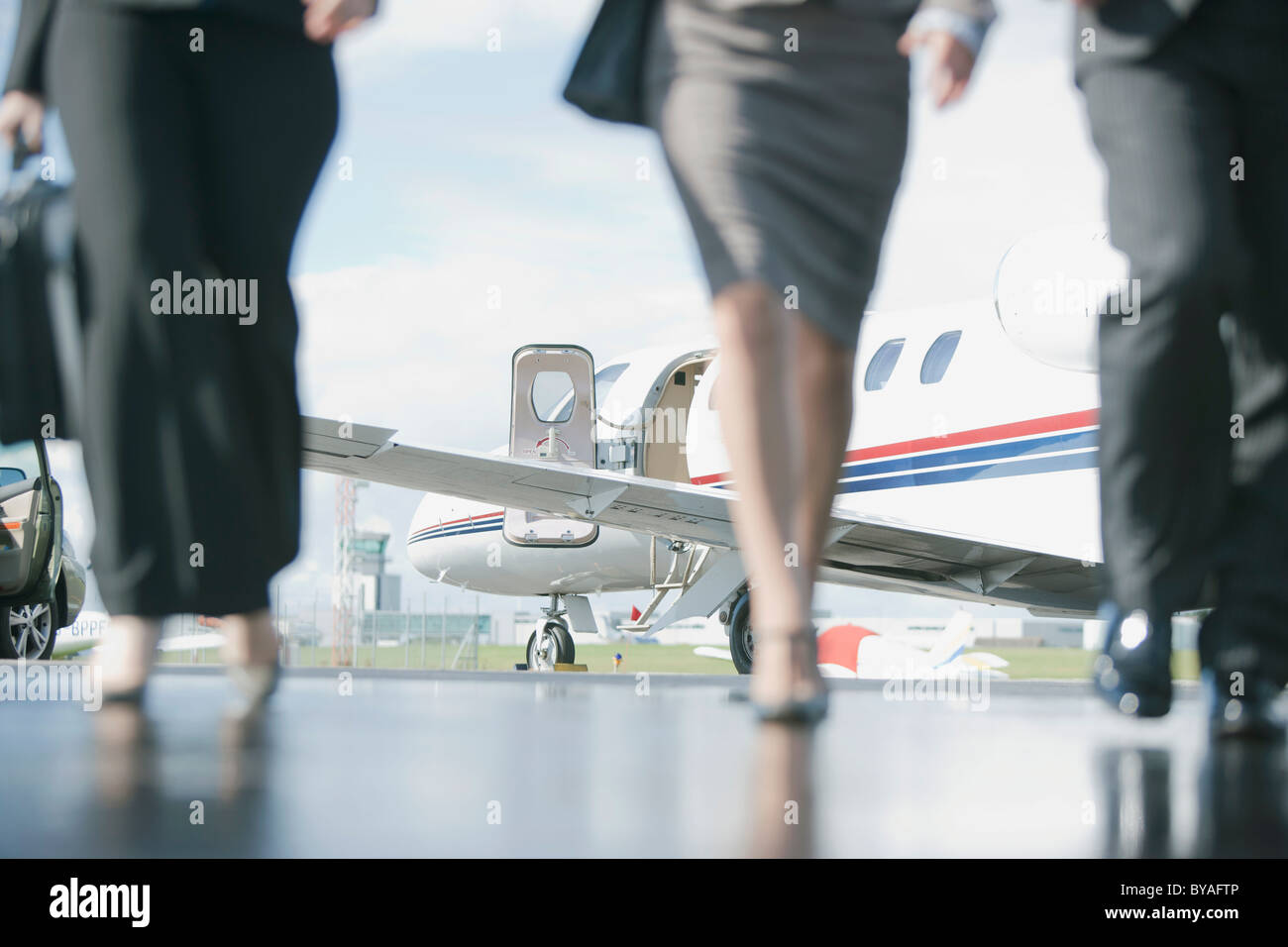 Business Executives on the move - Stock Image
