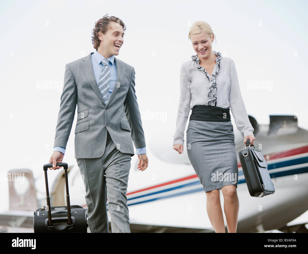 Business Executives smiling - Stock Image