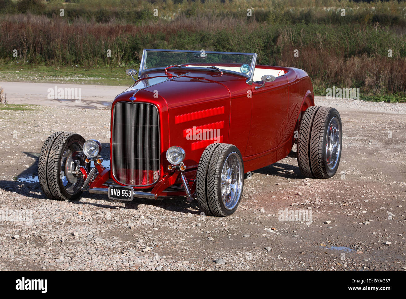 1932 Ford Roadster in red with black roof Hot rod Stock Photo ...