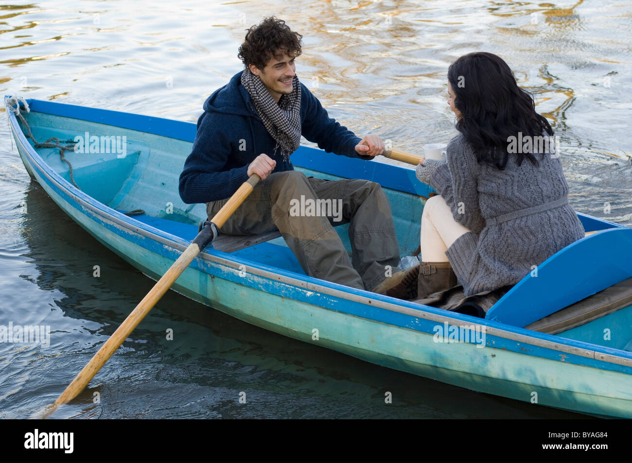 Couple in rowing boat - Stock Image