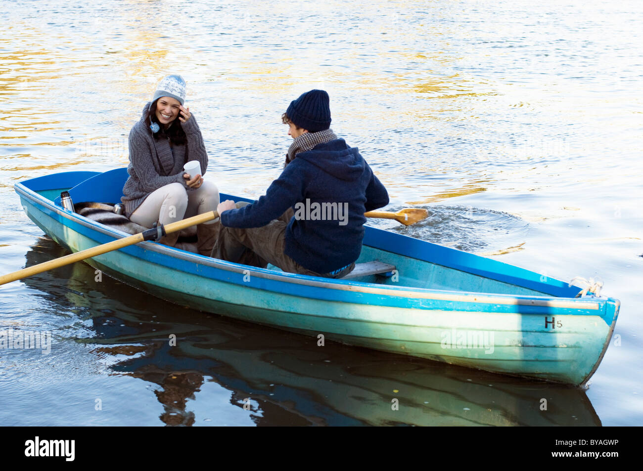 Couple in row boat having fun - Stock Image