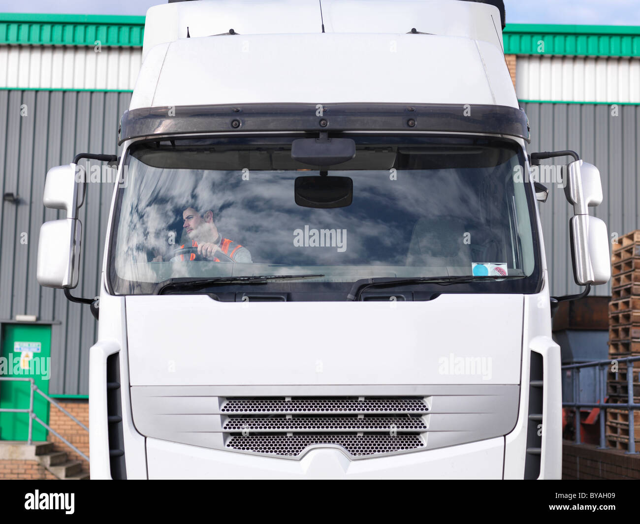 Truck driver in truck - Stock Image