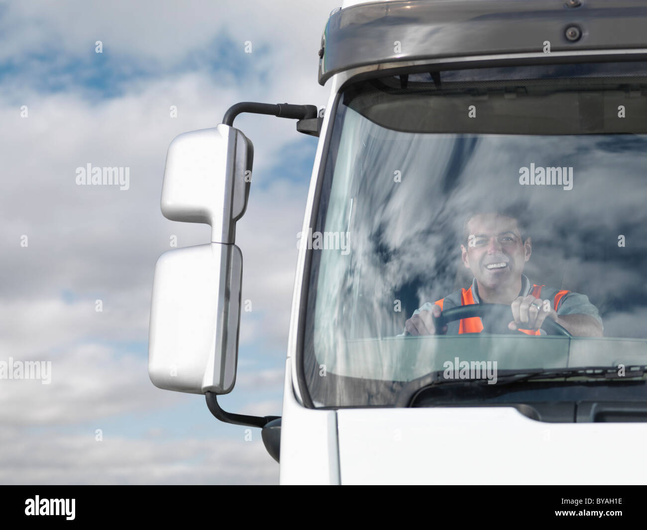 Driver in truck cab - Stock Image