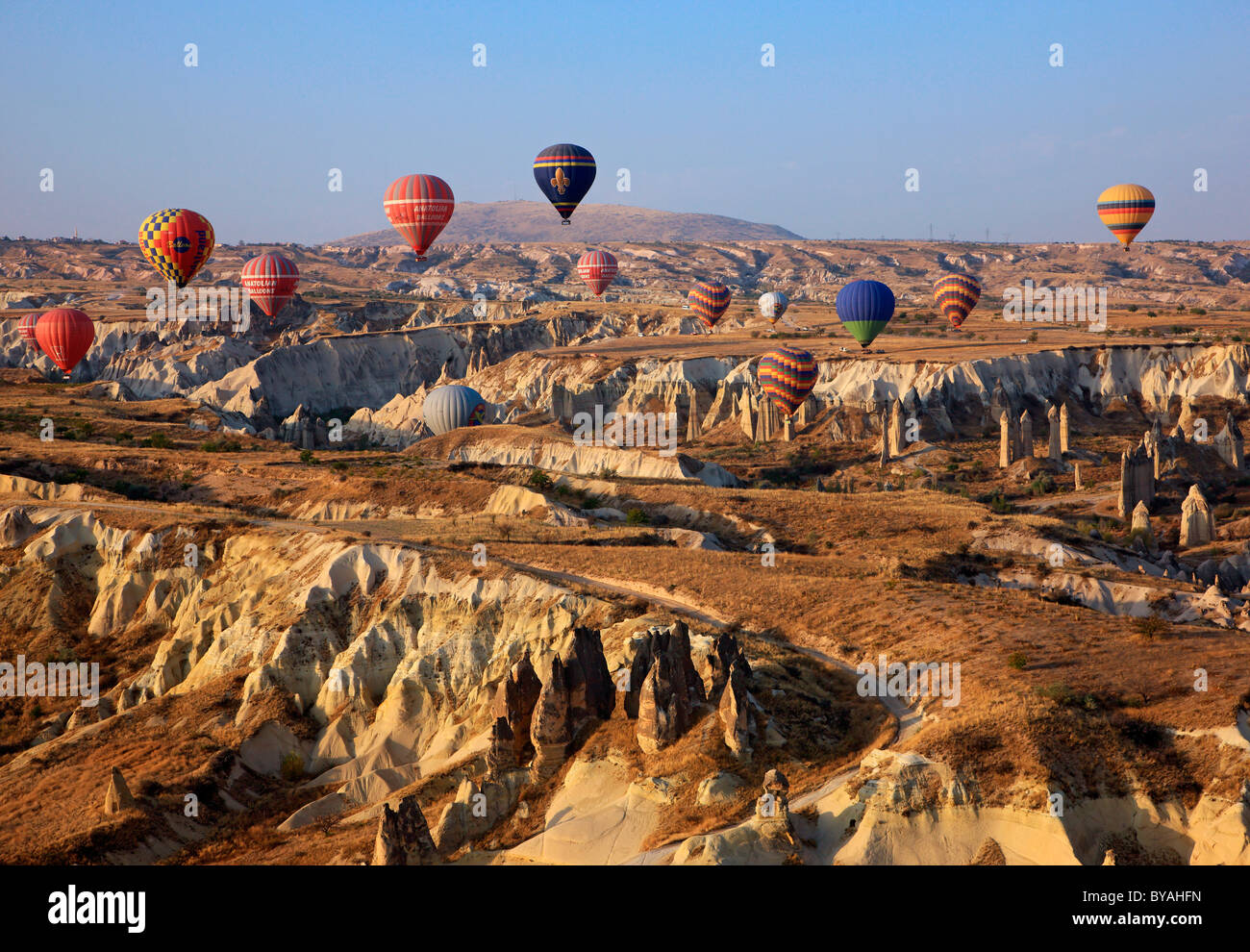 Hot air balloon flight above the spectacular landscape of Cappadocia, Turkey. In this photo, flying over Love Valley. - Stock Image