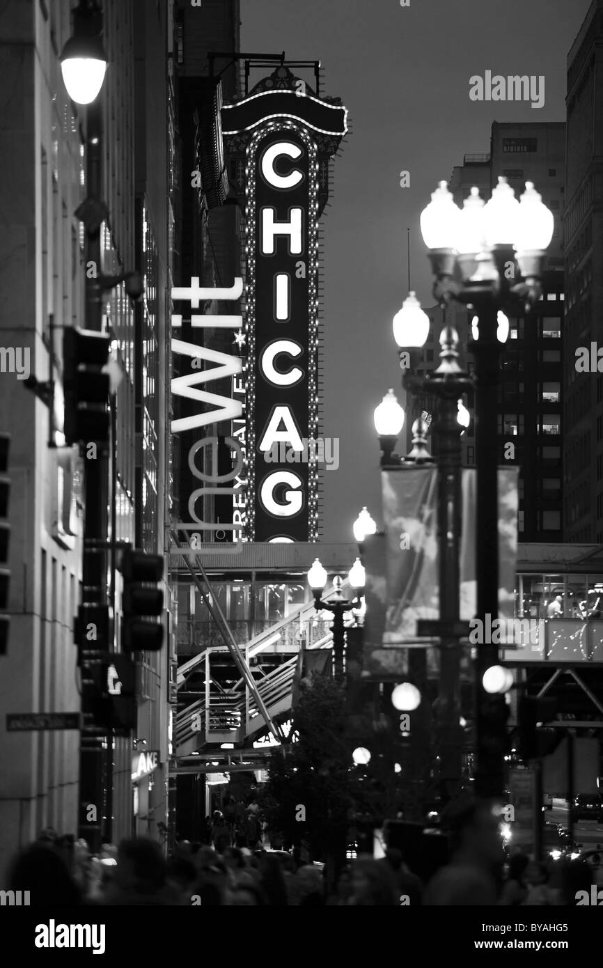 Black and white, night shot, neon sign of the Chicago Theater, River Loop, Chicago, Illinois, United States of America, - Stock Image