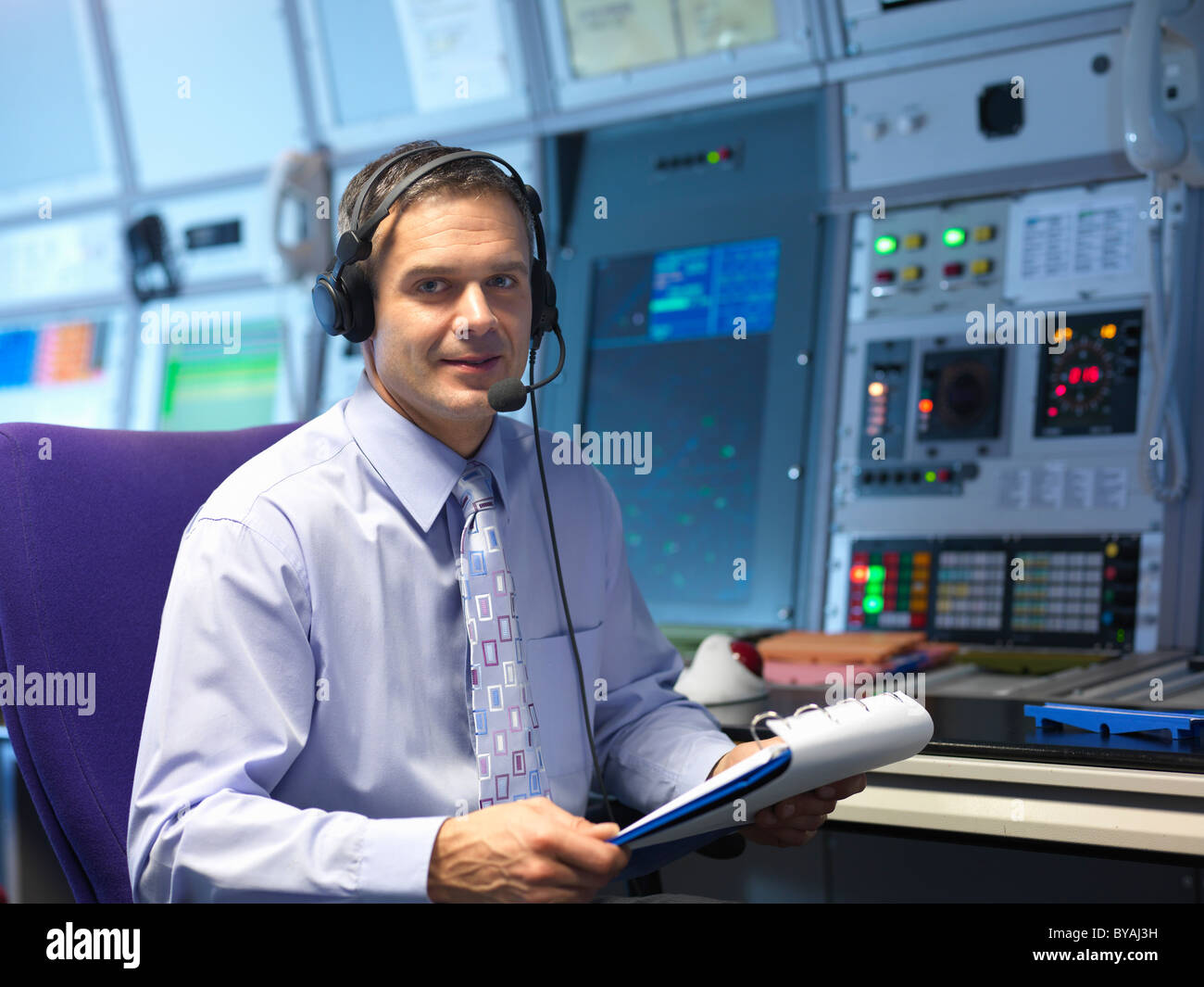 Air traffic controller in radar room - Stock Image