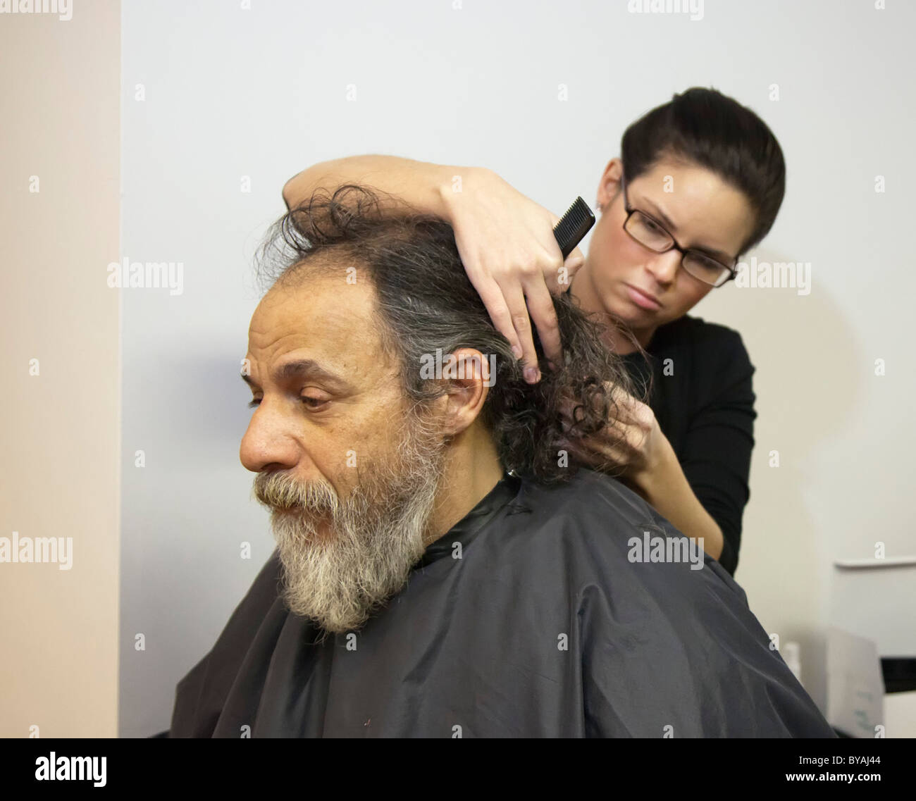 Homeless Boy Gets Bedroom For Christmas: Gets His Hair Cut Stock Photos & Gets His Hair Cut Stock