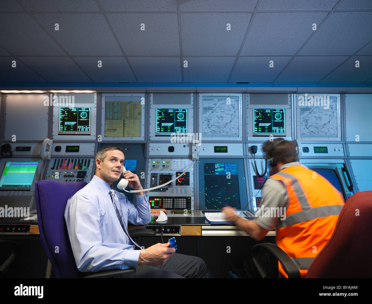 Air traffic controllers in radar room - Stock Image