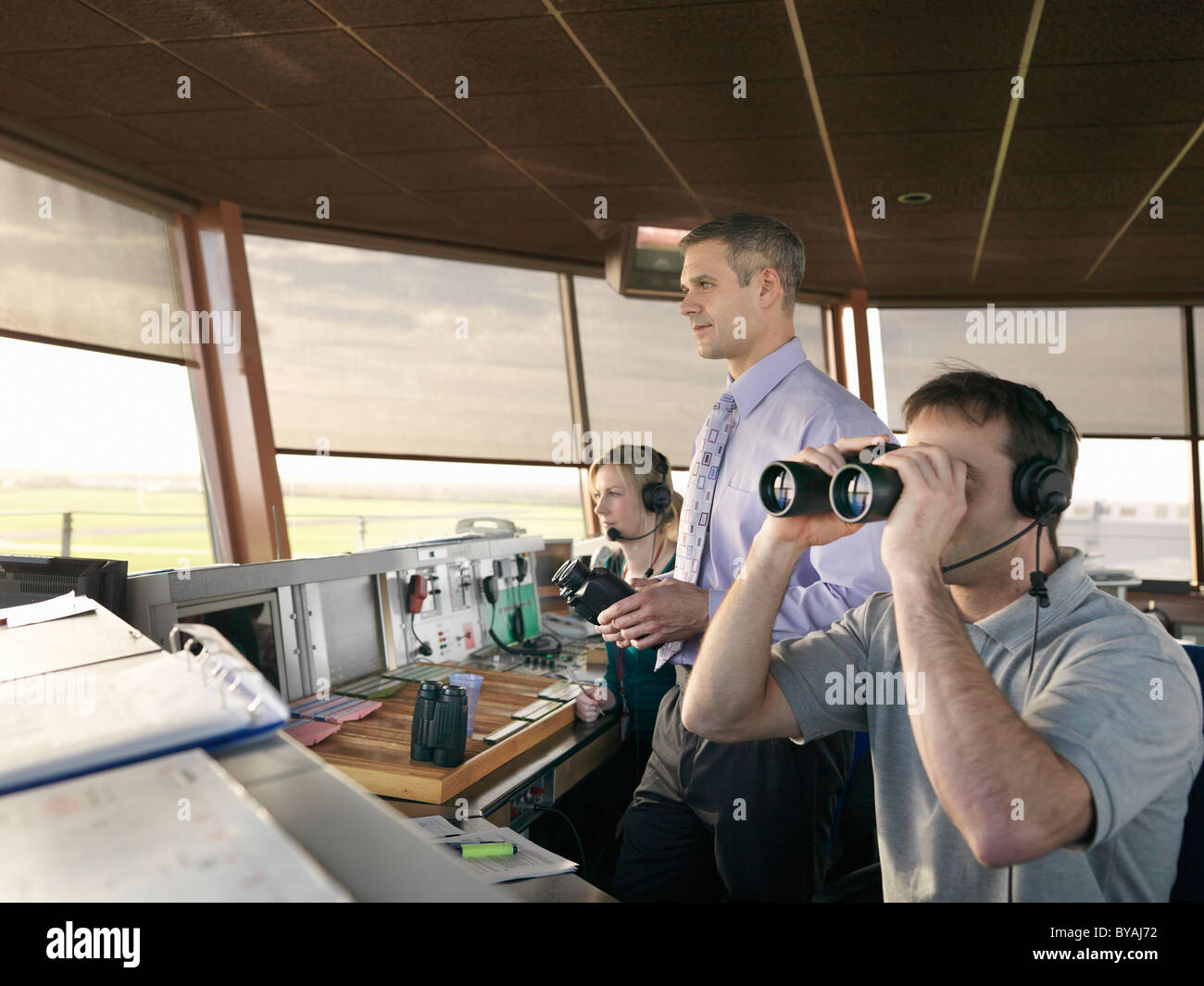 Air traffic controllers in tower - Stock Image