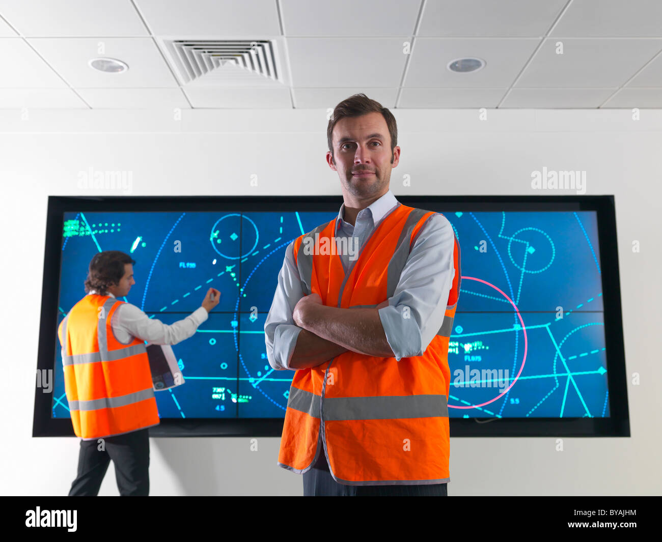 Air traffic controllers with screen - Stock Image