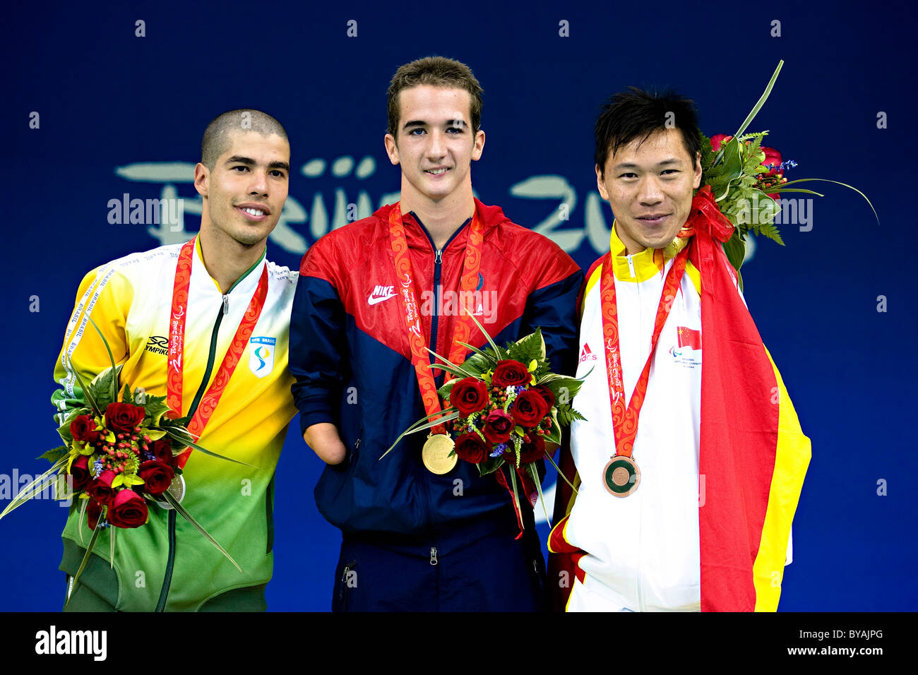 Medallists in the men's 50m Butterfly Roy Perkins USA - Gold, Daniel Dias Brazil - silver, Junquan He China - Stock Image