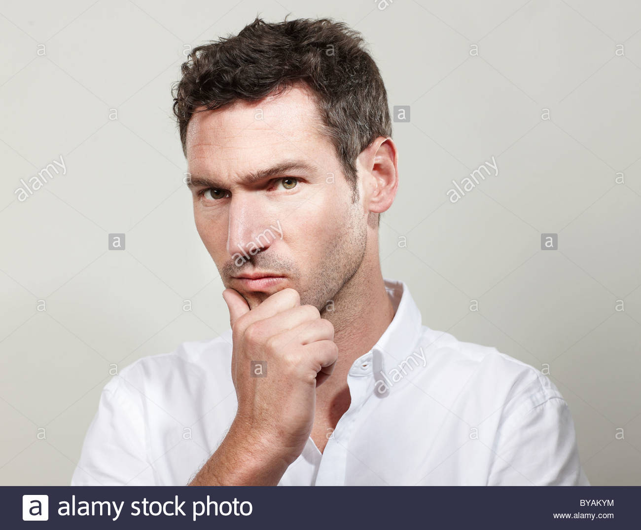 Portrait of man looking critical - Stock Image