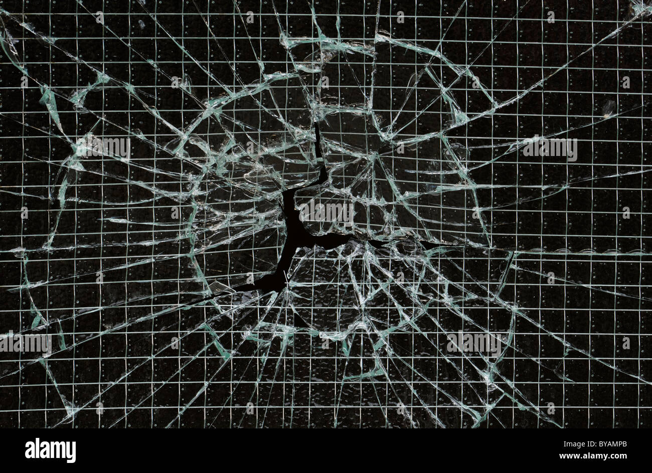 Cracked reinforced glass window - Stock Image