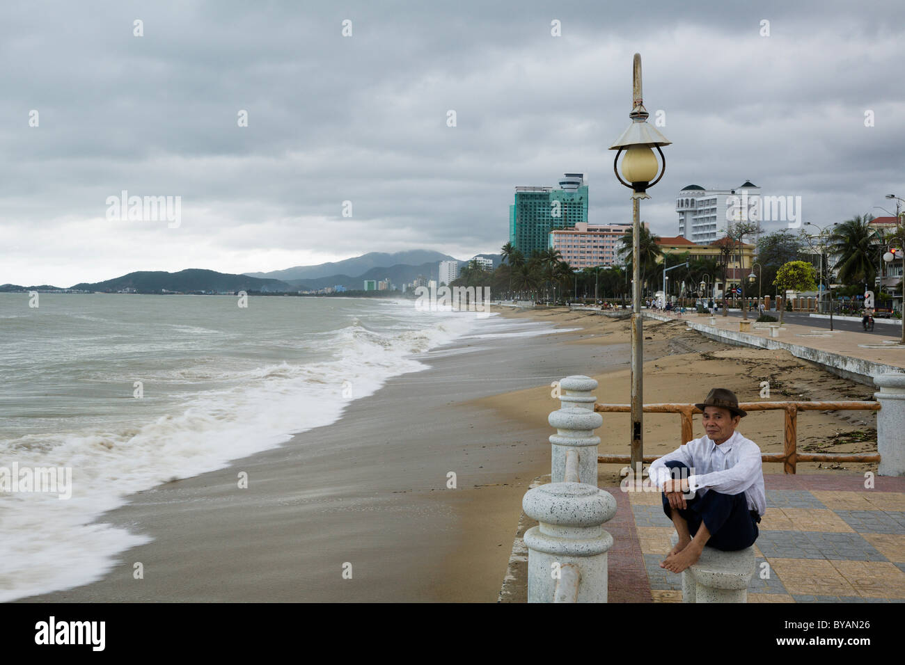 Man watching a storm by the beach in Nha Trang, Vietnam Stock Photo