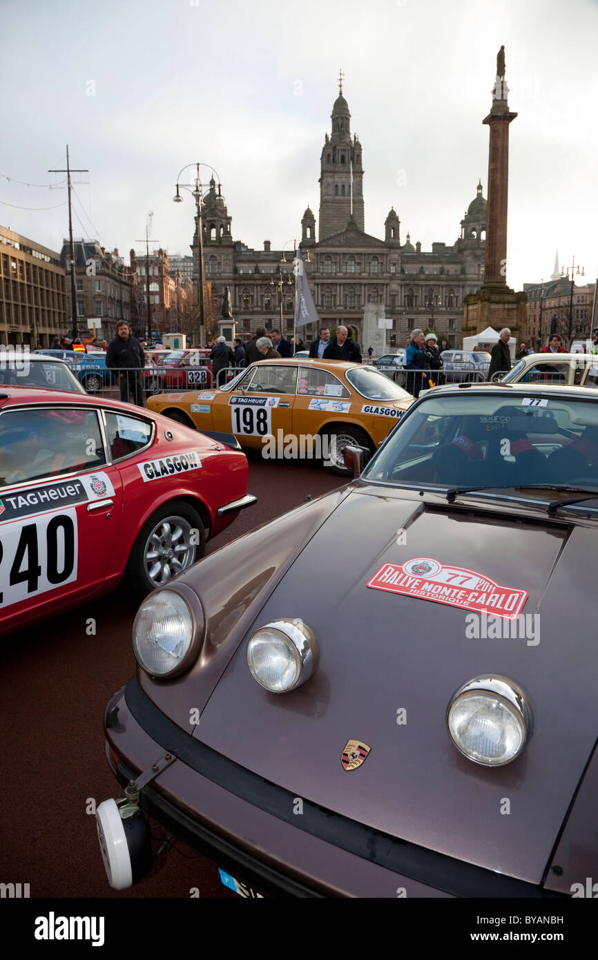 Porsche Carrera Alfa Romeo and Datsun 240 Rally cars parked in George Square Glasgow  for the 100th Monte Carlo - Stock Image