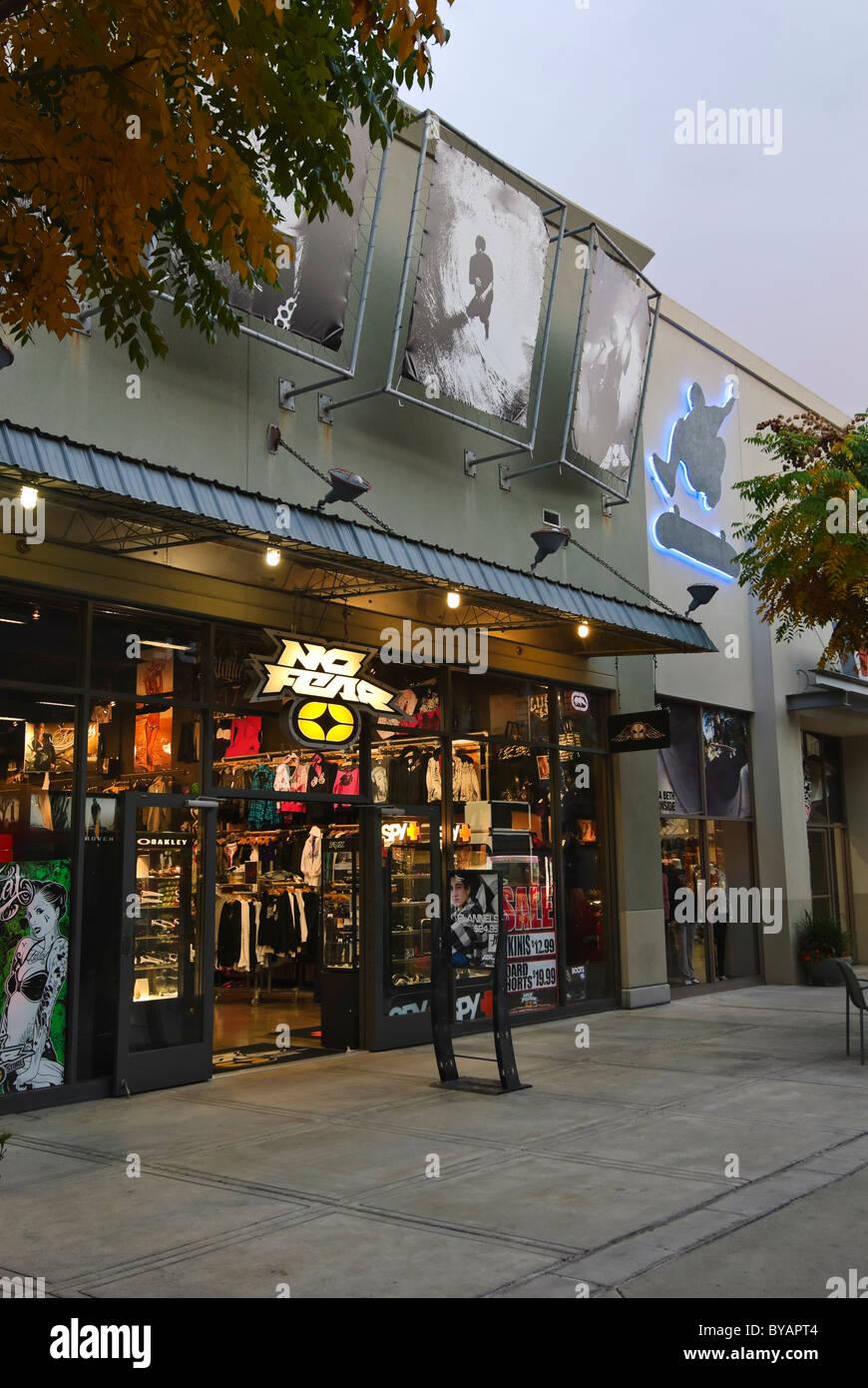 Vans skatepark and adjacent skate themed retail stores. - Stock Image