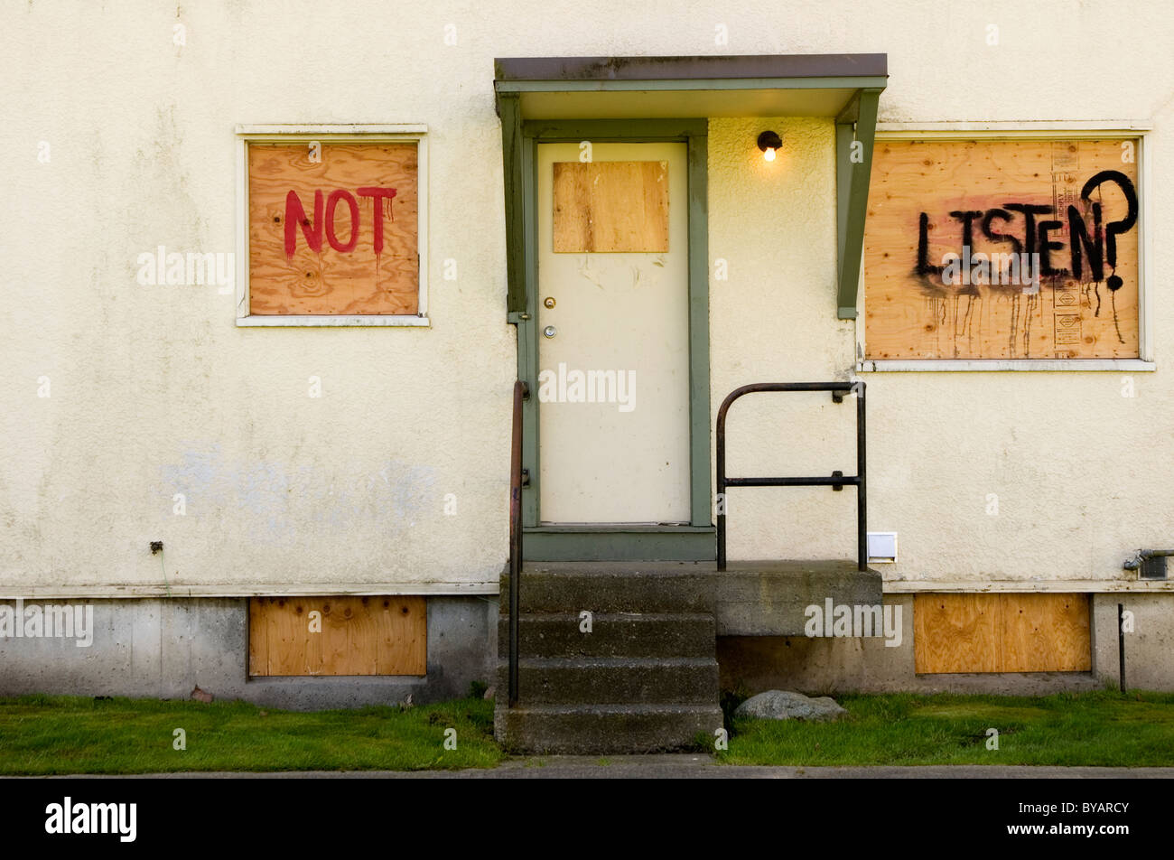 Boarded up dilapidated townhouse complex - Stock Image
