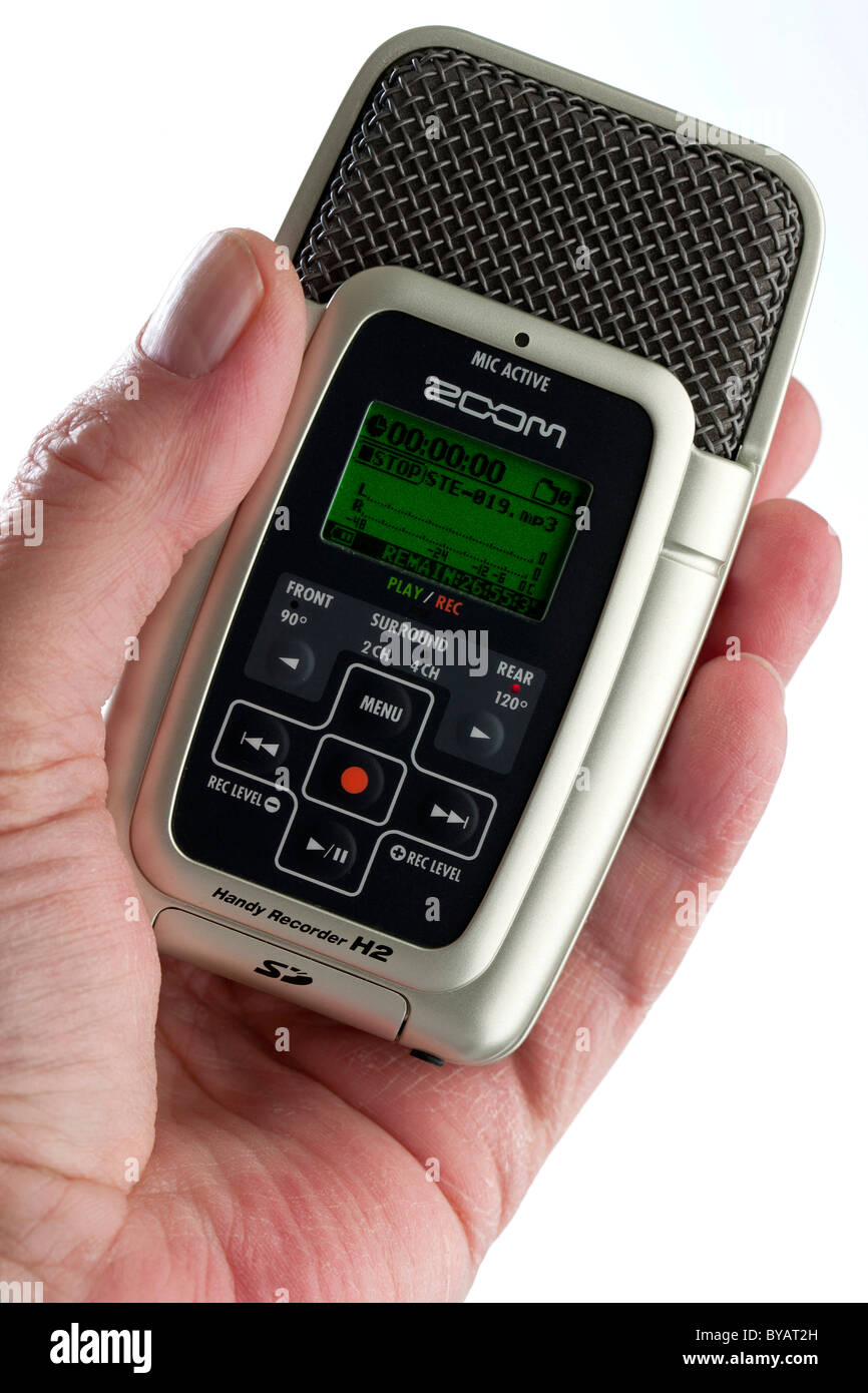 Mobile digital recorder placed held in hand - Stock Image