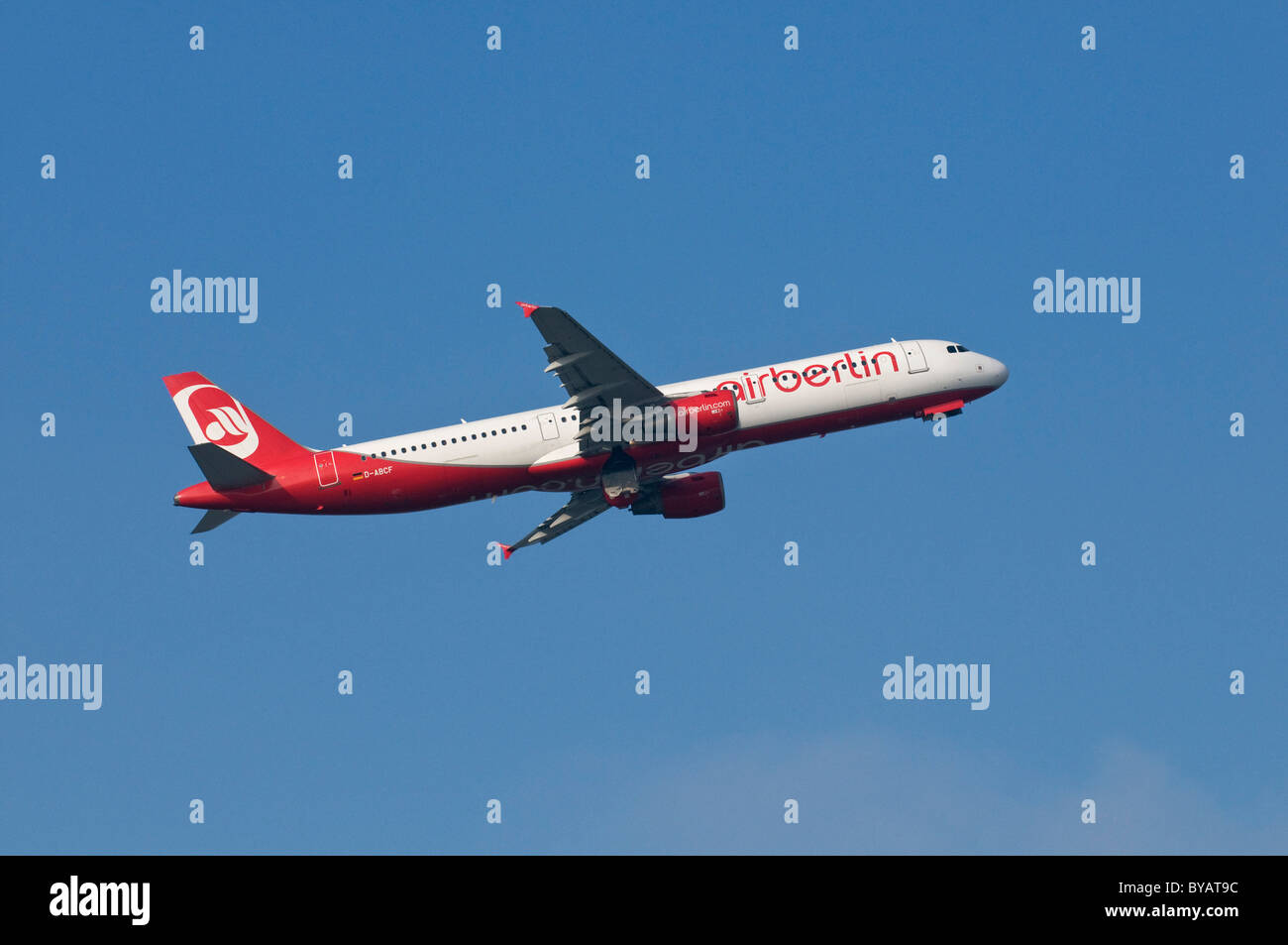 Airbus A321 of airline Airberlin after take-off with landing gear doors closing - Stock Image