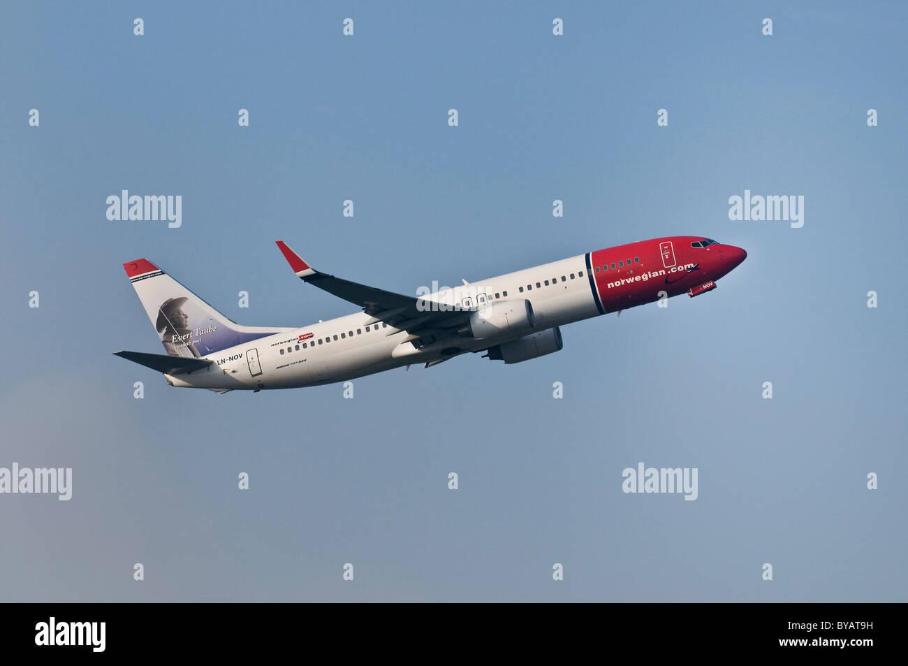 Norwegian Air Shuttle Boeing 737-8FZ, passenger plane climbing - Stock Image