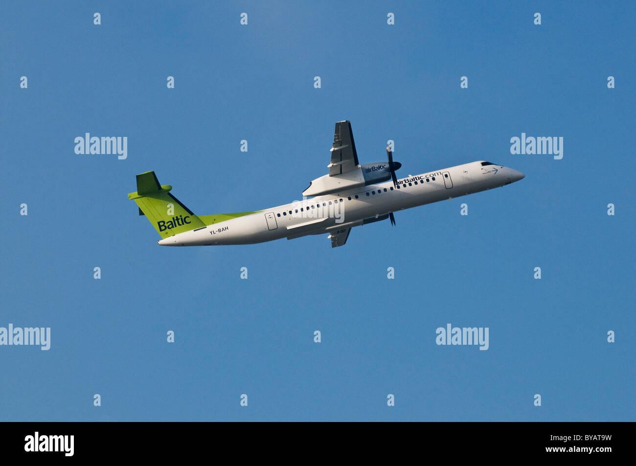Baltic Air De Havilland Canada, propeller aircraft climbing - Stock Image