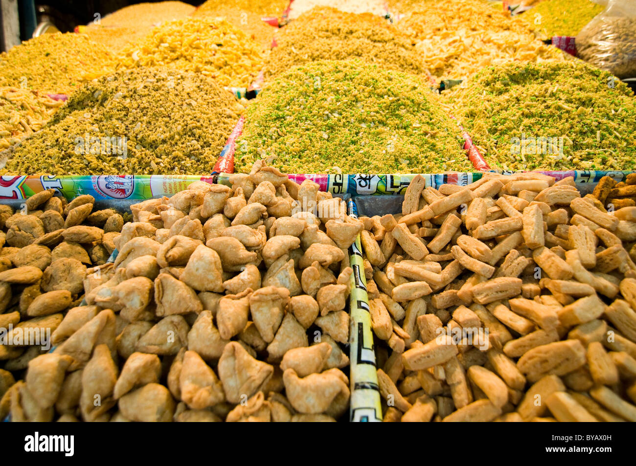 Indian salty snacks are sold throughout India. - Stock Image
