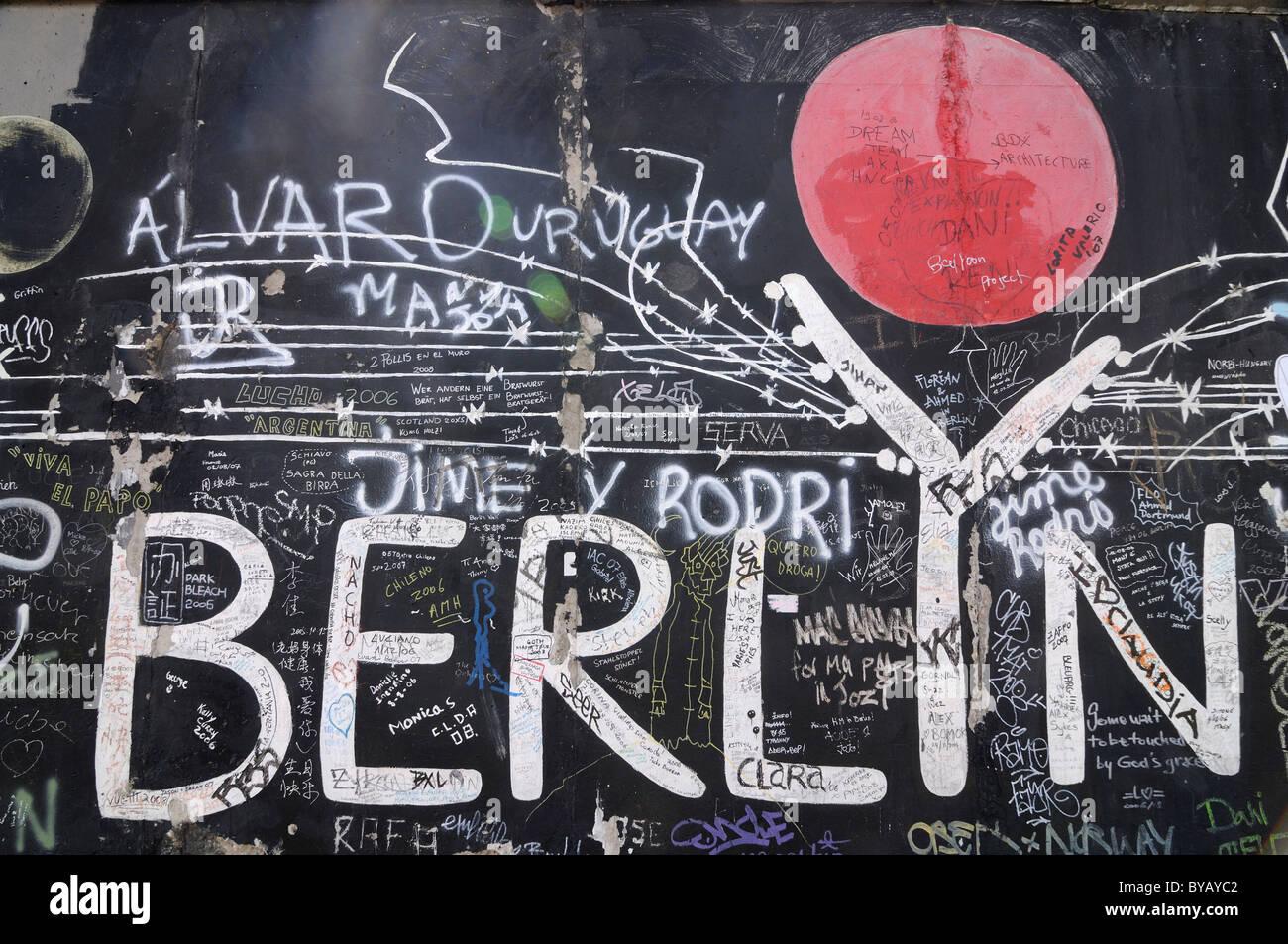 Berlin graffiti, East Side Gallery, Berlin, Germany, Europe - Stock Image