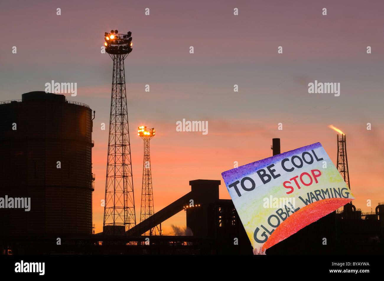 Emmissions from the Corus steelworks at Redcar UK, with a protest banner. - Stock Image