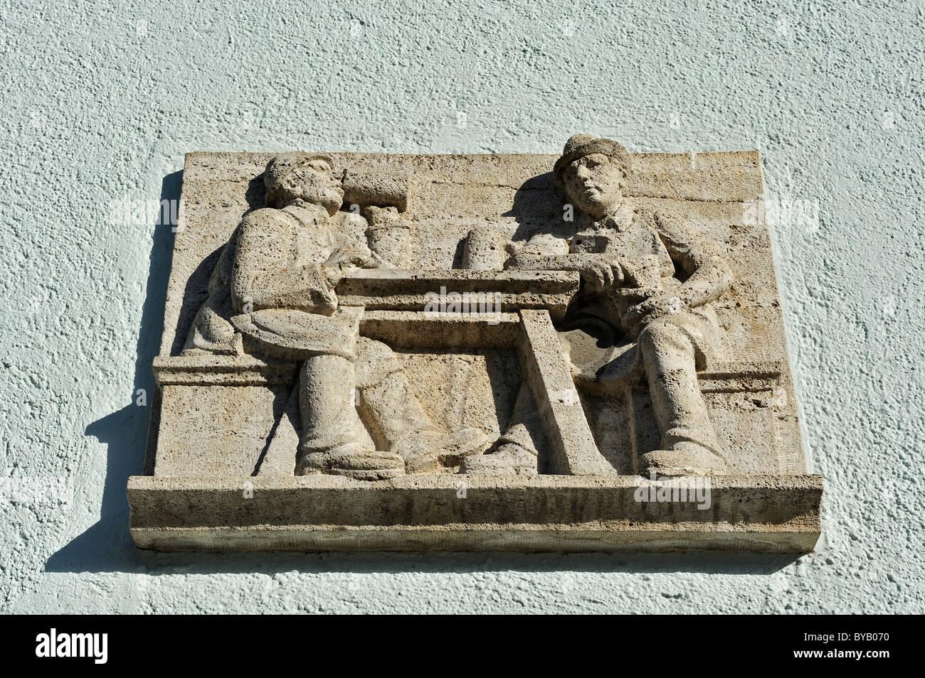 Symbolic relief of two men drinking, Harlaching, Munich, Bavaria, Germany, Europe - Stock Image