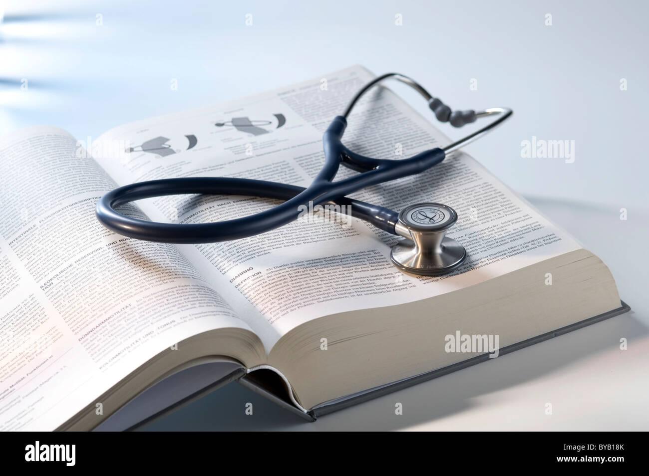 Stethoscope, medicine textbook - Stock Image