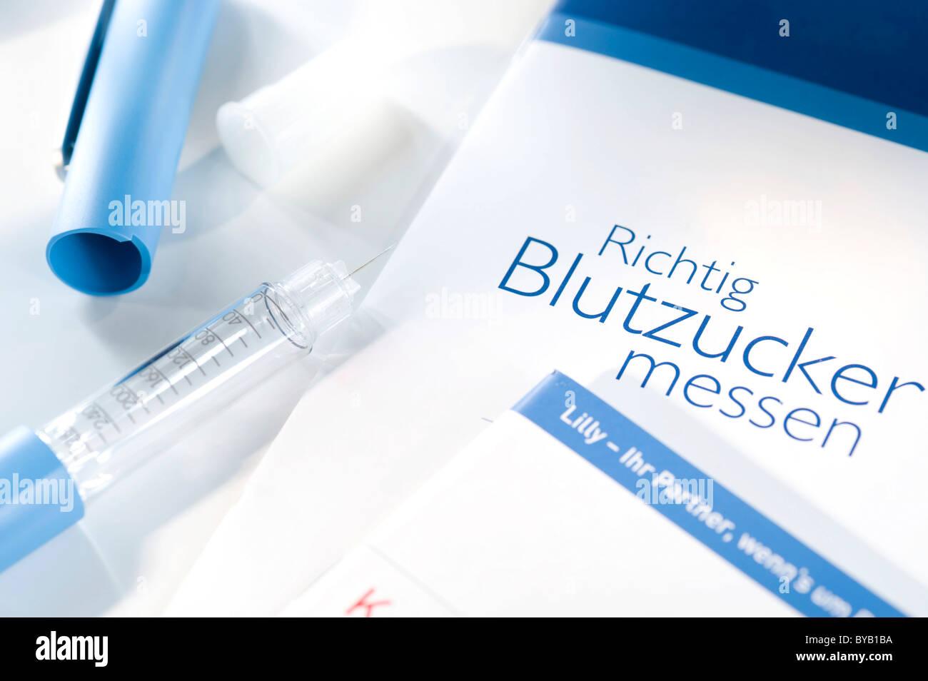 Blood glucose monitoring - Stock Image
