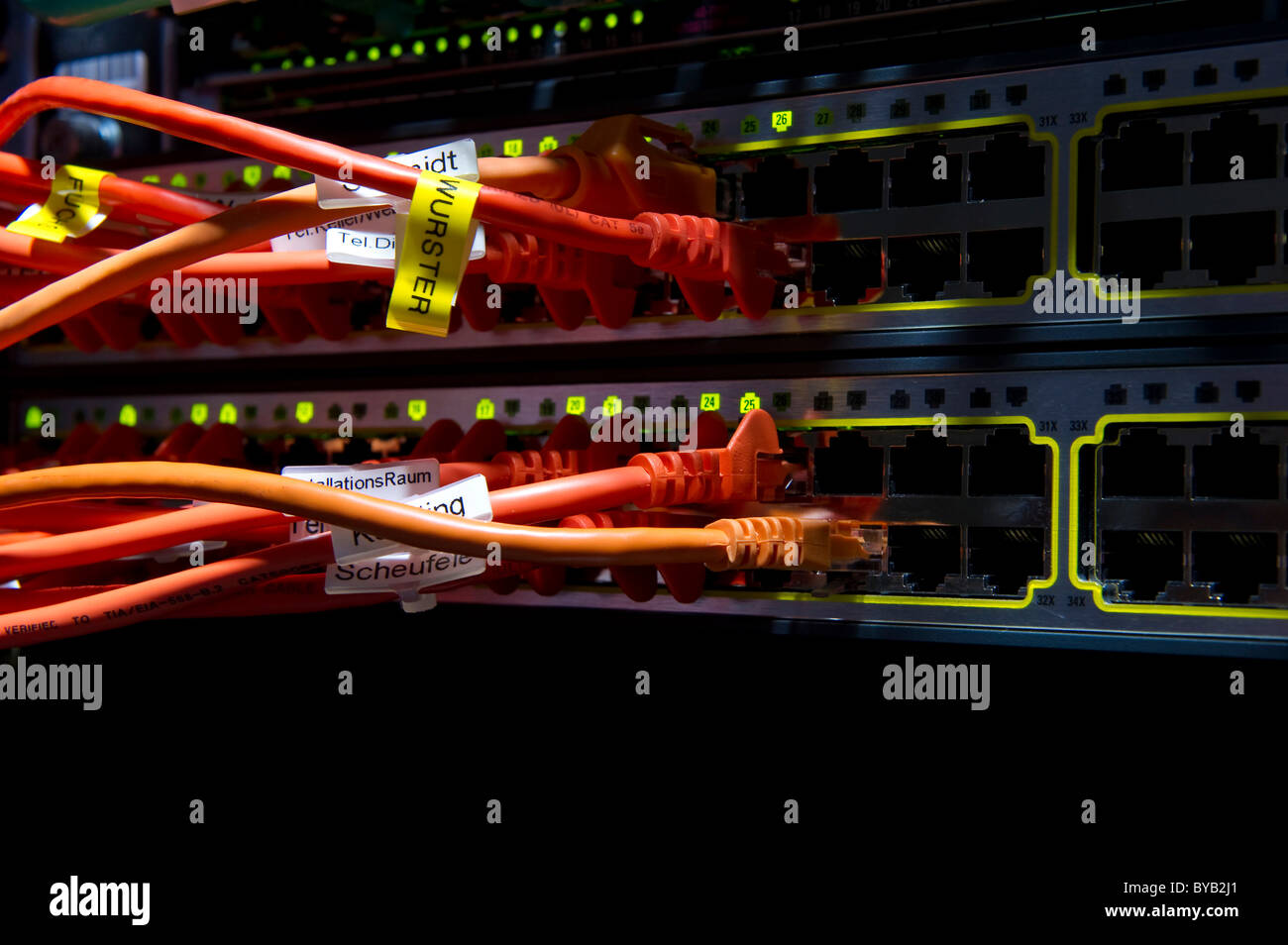 Cabling and jacks on an internet server - Stock Image