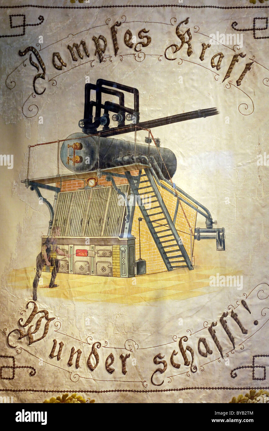 Historic union banner from 1899, with the motto steam power creates miracles, New Ruhr Museum, Zollverein Coal Mine - Stock Image