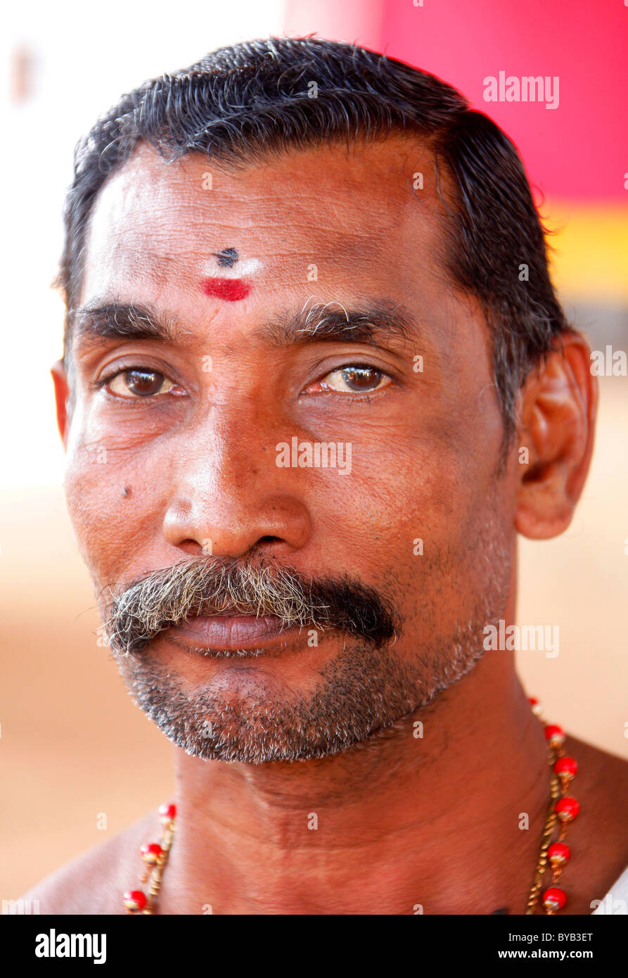 Indian believer, Hindu, with tilaka or tika mark, temple festival Utsav, Ettumanur temple, central sanctuary, Lalam - Stock Image