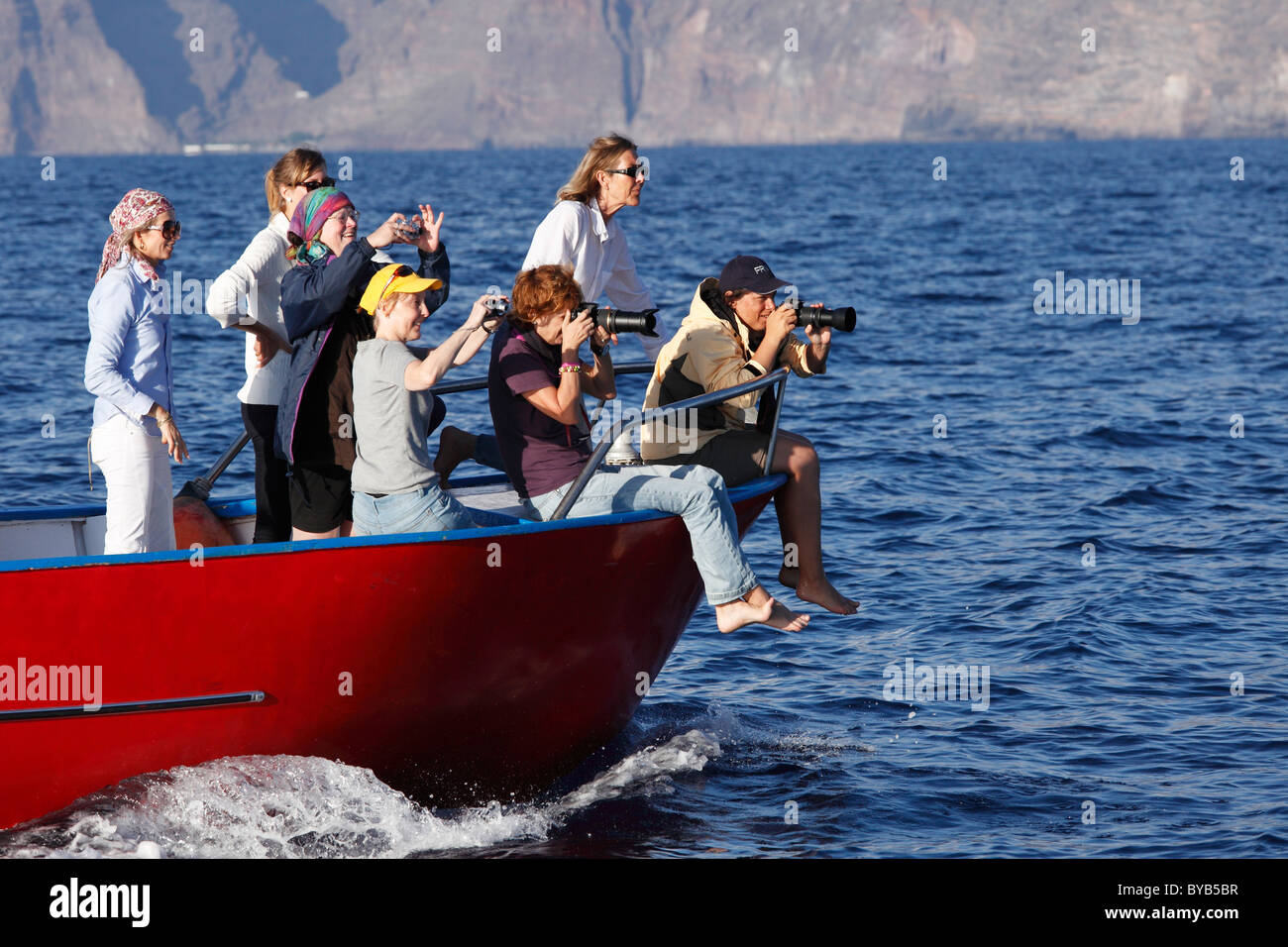 Photographing women in a boat, whale watching, La Gomera, Canary Islands, Spain, Europe - Stock Image