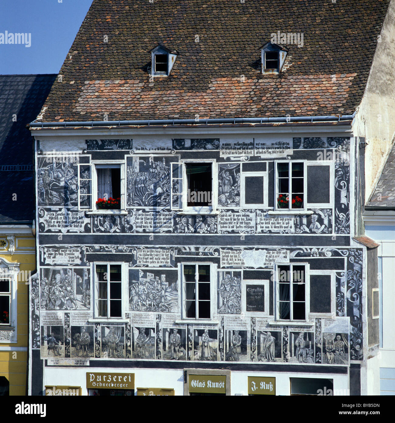 Roman virtues and the ages of a man on a facade, Rathausplatz 4, Weitra, Waldviertel, Lower Austria, Europe - Stock Image