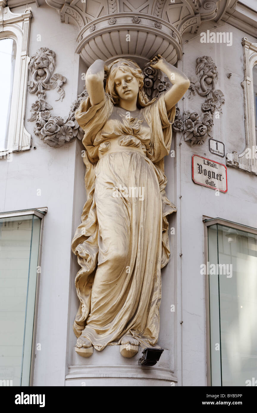 Atlas statue and stucco on the facade of a house, Gruenderzeit style, Tuchlauben shopping street, 1st district, - Stock Image