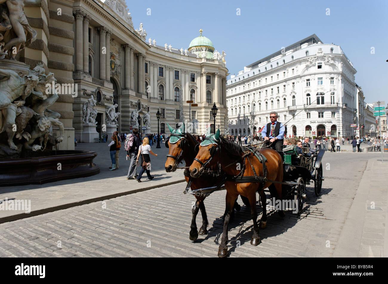 Fiaker taxi carriage on Michaelerplatz square, 1st district, Vienna, Austria, Europe - Stock Image