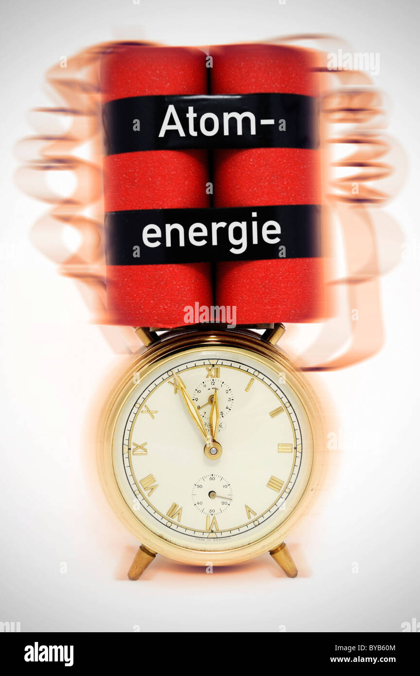 Time bomb, alarm clock with explosive device, symbolic image for nuclear energy - Stock Image