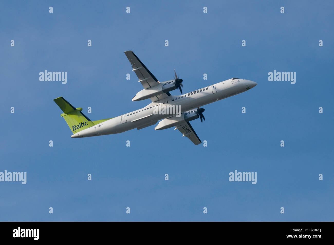 Air Baltic de Havilland Canada DHC-8-400Q Dash 8 in ascent, regional aircraft by Bombardier - Stock Image