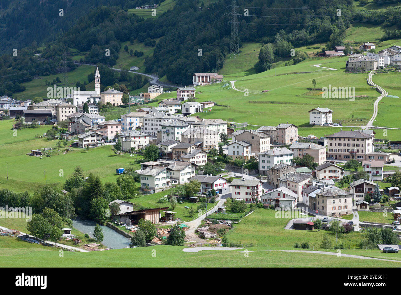 View on the small town of San Carlo out of the train of the Rhaetian Railway, Bernina Express, Engadin, Canton Grisons - Stock Image