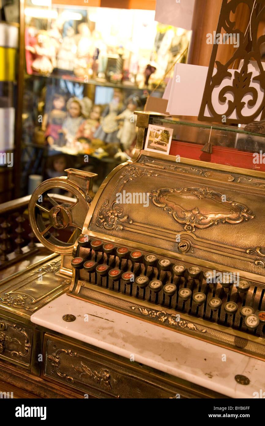 Antique cash till in French doll shop, Paris - Stock Image