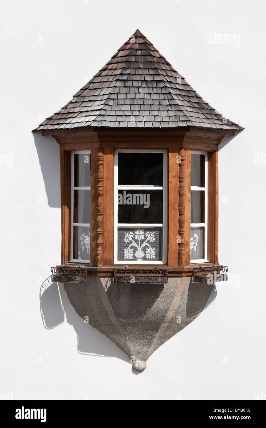 Bay windows of a historic building facade in Sent, Lower Engadine, Graubuenden or Grisons, Switzerland, Europe - Stock Image