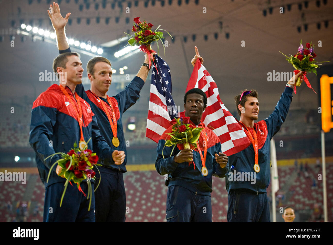 USA team celebrate on the podium with their gold medals after victory in the men's T44 4x100m final relay race - Stock Image