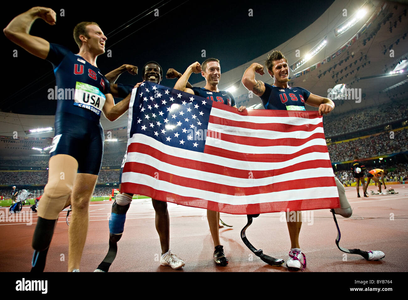 USA team members celebrate after their victory in the men's T44 4x100m final relay race at the Beijing 2008 - Stock Image