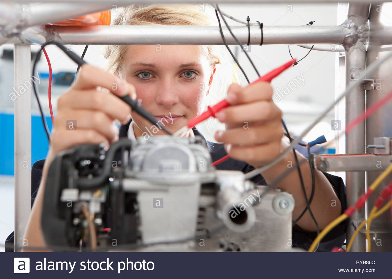 Student constructing electric vehicle prototype in vocational school - Stock Image